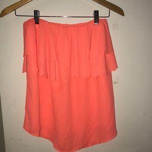 Bright orange strapless shirt